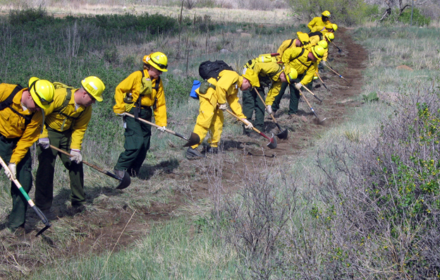 firefighters digging a fireline